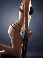 Seductive woman in black lingerie