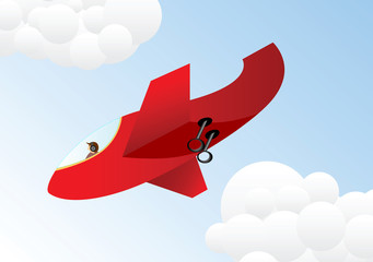 Red plane on a blue sky background