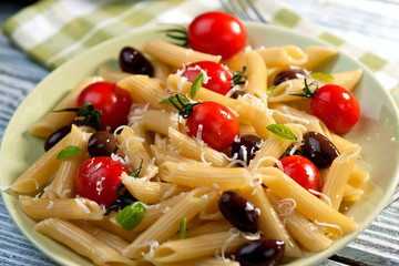 Wall Mural - Pasta with fresh tomatoes and olives