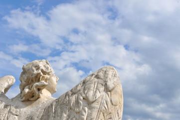 Angel facing blue sky