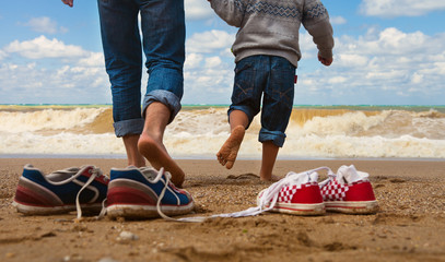 Father and son walk at the seaside