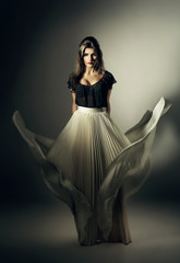 pretty woman in white skirt on wind