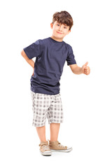 Full length portrait of a young boy giving a thumb up