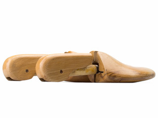 Close up wooden shoe stretcher isolated on white background