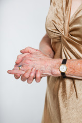 Closeup of hands of senior woman wearing a watch.