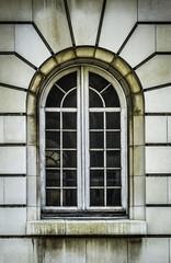 Aged arch white window