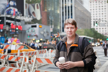 Young man on way to work in New York city