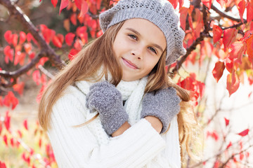 Child girl in winter clothes