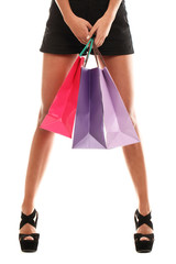 Woman legs in shoes and shopping bags isolated on a white