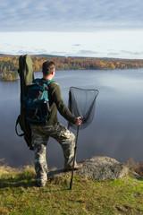 Angler on the hills edge