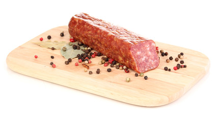 Tasty sausage on chopping board isolated on white