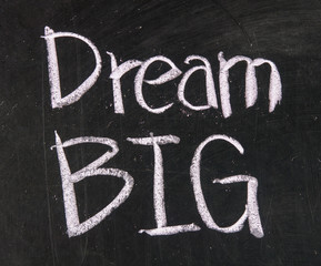 Dream big text written on a blackboard