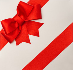 red ribbon bow on grey gift box