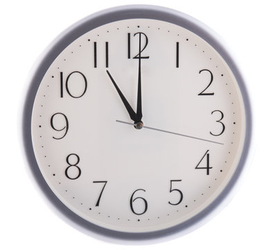 isolated white clock at eleven