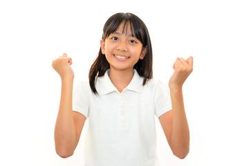 ガッツポーズをする笑顔の女の子