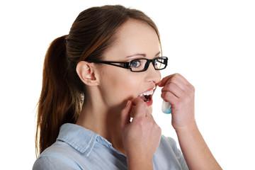 Beautiful caucasian woman using dental floss