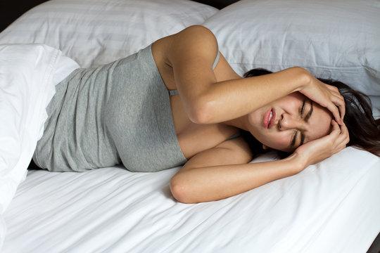 woman with headache, migraine, stress, insomnia, hangover