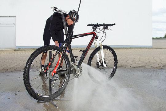 man washing the bike