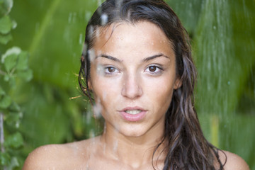 woman in tropical shower with palm and banana trees