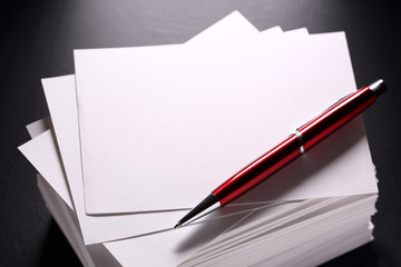 Stack of paper cards and pen
