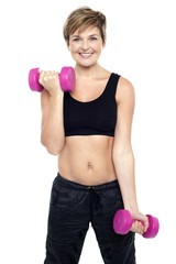 Cheerful middle-aged woman woman working out
