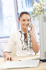 Happy callcenter operator girl at desk
