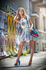 fashion urban portrait of beautiful model with sun glasses