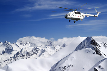 Wall Mural - Helicopter in winter mountains