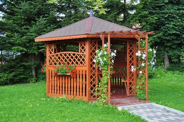 Fototapeta Gazebo in the garden - wooden house obraz