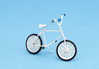 small bicycle toy on azure background