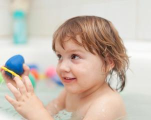 baby girl bathes  in bath