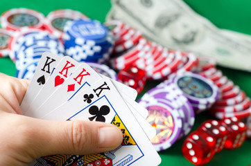 Card for poker game, chips for poker on the green background