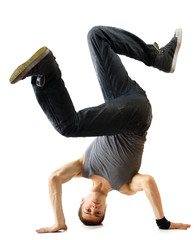 Young handsome fresh man breakdancing