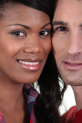 Closeup on the faces of a young couple