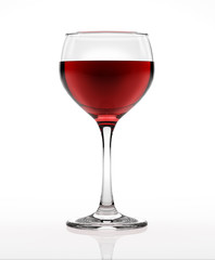 Red wine glass, on white surface and background, viewed from a s