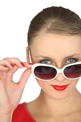 Woman wearing oversized sunglasses