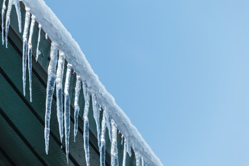Hanging icicles on a roof