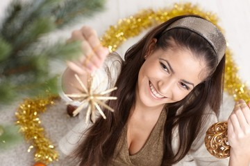 Happy woman at christmas decoration