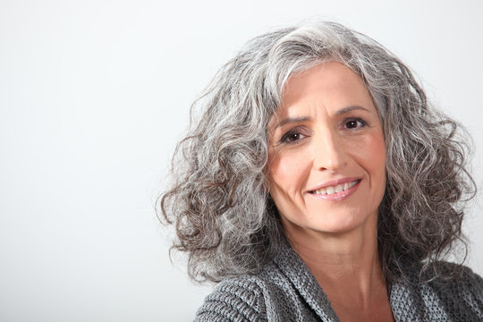 Grey-haired woman on white background