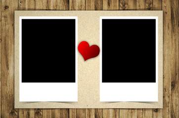 Blank photo and red heart isolated on wooden background