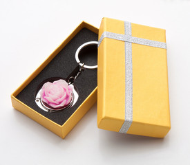 Pink rose keychain store in the beautiful yellow box