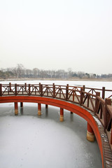 Chinese traditional style wooden bridge in the snow