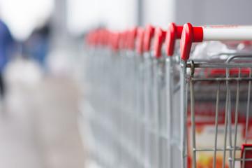 Row of shopping carts near entrance of supermarket