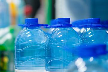 Blue bottles of fresh water in supermarket