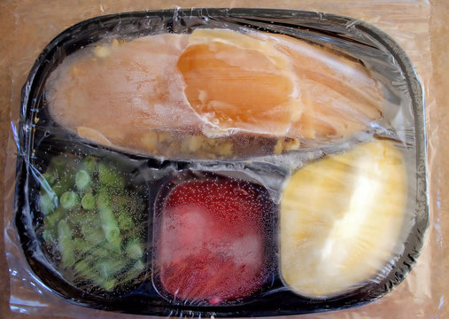 Frozen Turkey Dinner - covered with plastic, condensation inside