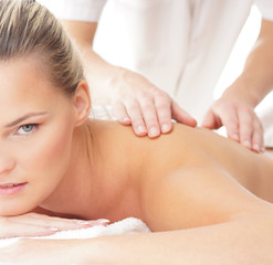 Portrait of a young woman on a spa massage procedure