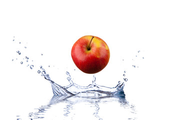 Red apple splashing into water depth