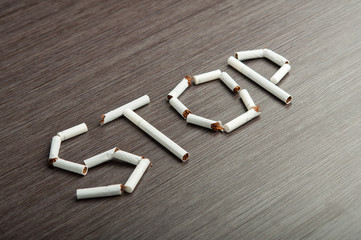 """concept of dangers of smoking. word """"stop"""" of cigarettes"""