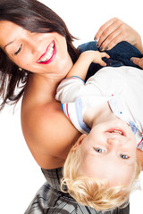 Happy woman playing with child boy