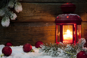 Christmas lantern in night on snow with baubles  background